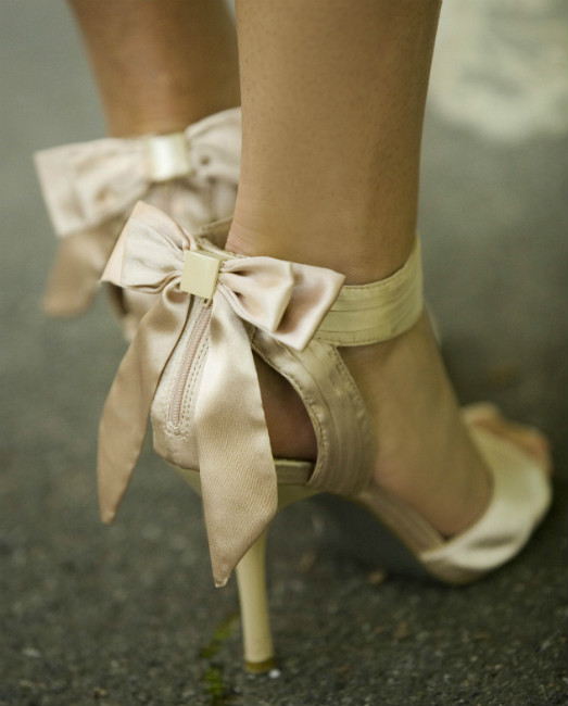 Champagne open toe sandals with feminine back ankle bow