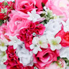 Bright summer bouquet with fuchsia, pink and white roses and jewel accents