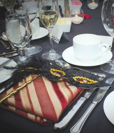 Masquerade-themed place setting