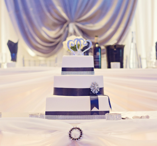 3 tiered with black and rhinestone ribbon wrapped around, topped with rhinestone hearts