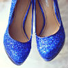 Blue-sequined round-toe Nine West pumps