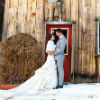 bride and groom outside the barn
