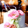 Romantic white cake with pink and green flowers