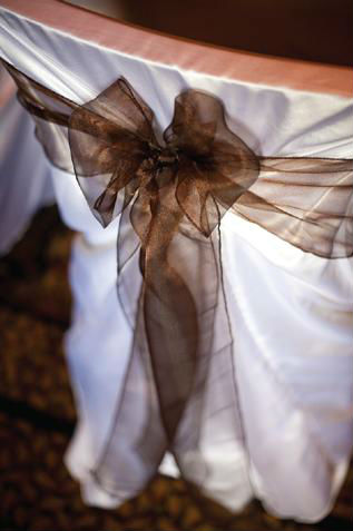 Satin chair cover with sheer brown bow