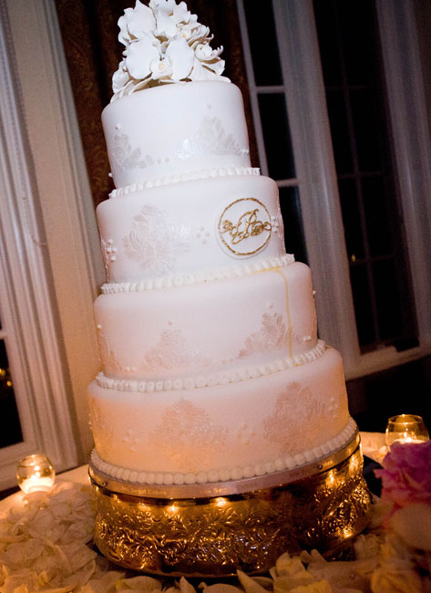 Five tier white cake with metallic stencil design