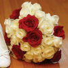 White rose bouquet with red rose accents