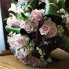 Pastel bouquet with white, light pink and light blue flowers and assorted greenery