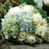 Blue and white bouquet with white roses, blue hydrangea and baby&#39;s-breath