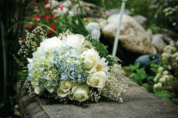 Blue and white bouquet with white roses, blue hydrangea and baby's-breath