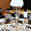 Black & white décor, black satin napkins, tall white flower centerpieces