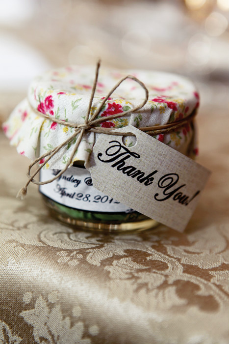 Rustic favour jars with floral fabric lid