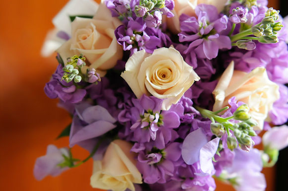 Beautiful nosegay bouquet with cream and purple flowers