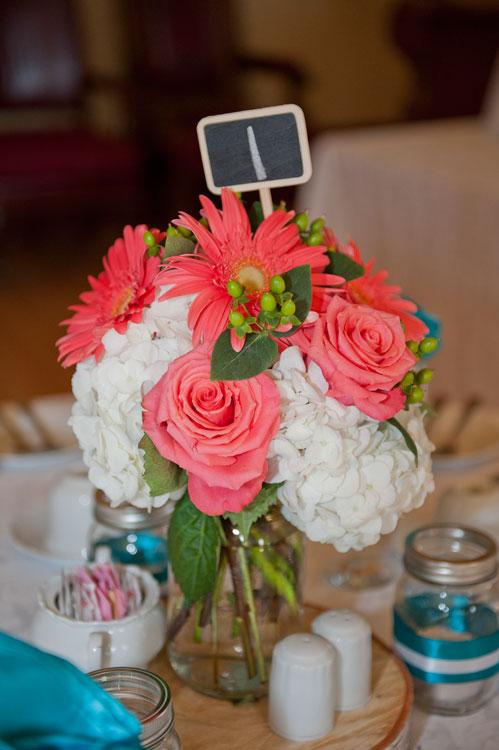 Wedding centrepiece ideas todaysbride mason jars with white and coral flowers on small tree trunks mightylinksfo