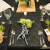 Black and white ribbon details with rustic, wild leaves and flowers
