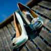 Ice blue satin peep-toed Badgely Mischka pumps with brooch detail