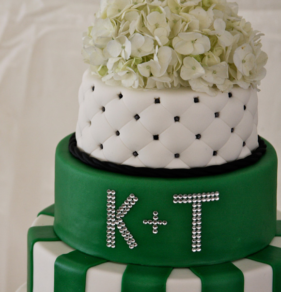 Modern three tier cake with white and green fondant accents, black and white quilted top layerm crystal monogram detail
