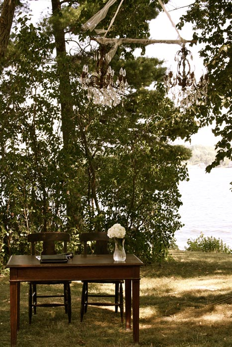 Vintage table and chairs at a rustic outdoor ceremony
