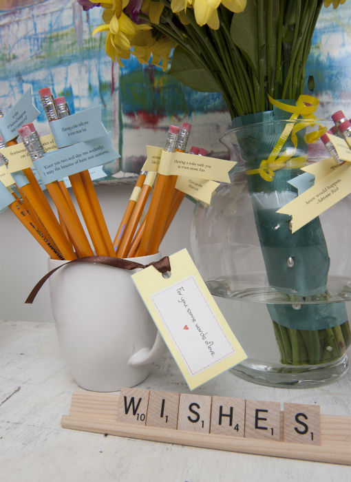 "HB pencils with ""poetry"" flags and packets of tea"