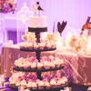 3 tier cupcake stand with top tier wedding cake and bride & groom bird toppers