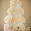 4 tier elegant white cake with bursting flower layers