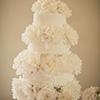 4 tier elegant white cake with bursting flower layers
