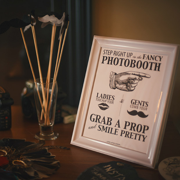 Black and white vintage-style photobooth sign with mustache details