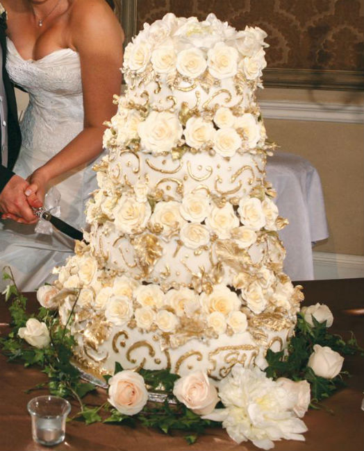 White rose bud three tier cake with piped gold design