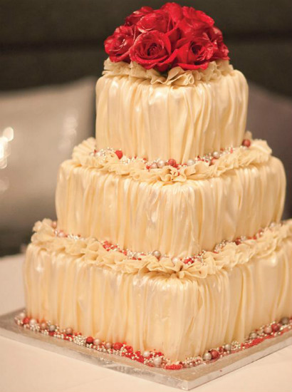 Ruched champagne fondant cake with red fondant roses and ruffles