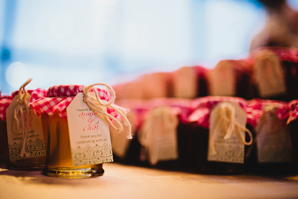 Personal honey favour jars with gingham fabric lid