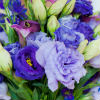 Garden bridal bouquet with blue, lavender, white and green flowers