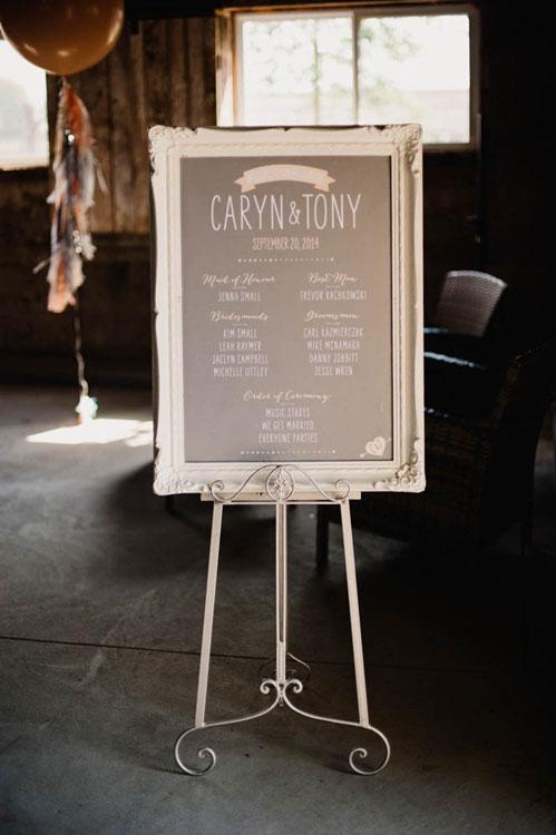 Wedding program in gold frame on easel